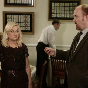 "PARKS AND RECREATION -- ""Dave Returns"" Episode 415 -- Amy Poehler as Leslie Knope, Louis C.K. as Dave Sanderson"