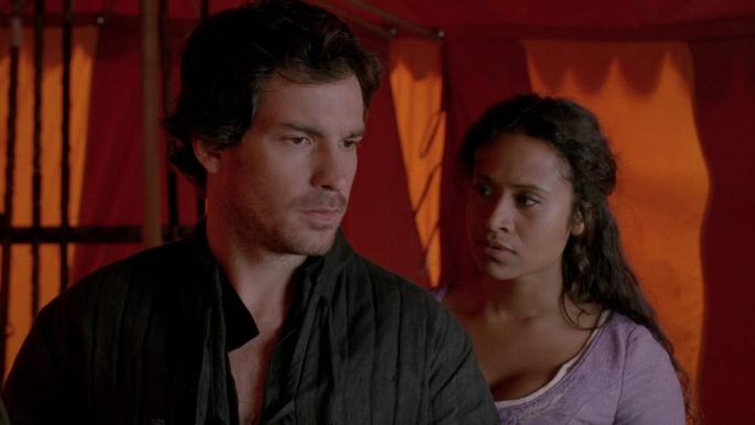 Lancelot (Santiago Cabrera) and Gwen in his empty tent