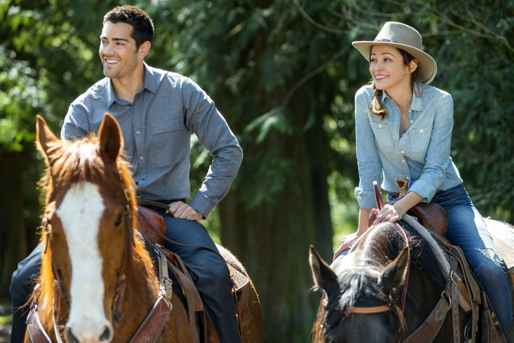 A COUNTRY WEDDING - Before his wedding to his movie star fiancé, country music sensation Bradley Suttons must visit his rural hometown to sell his family's former house. While there, he reconnects with Sarah - an old friend he gave his late mother's ring to during their make-believe childhood wedding.  Photo: (L to R) Jesse Metcalfe, Autumn Reeser  Credit: Copyright 2015 Crown Media United States, LLC/Photographer: Bettina Strauss