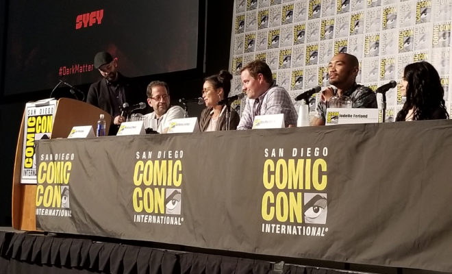 Cast of Dark Matter at SDCC 2017, sitting at a table with microphones